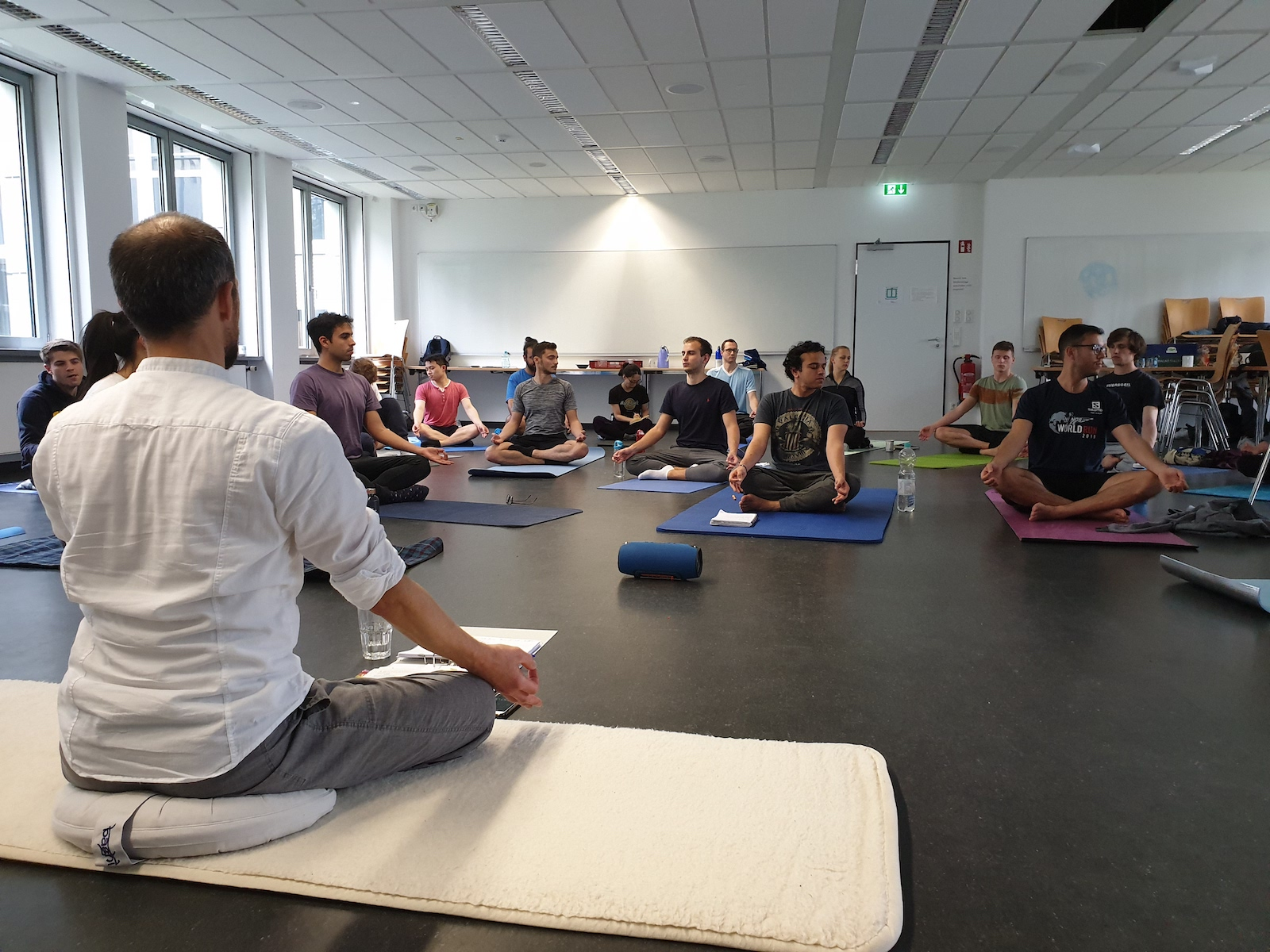Students and the instructor meditating